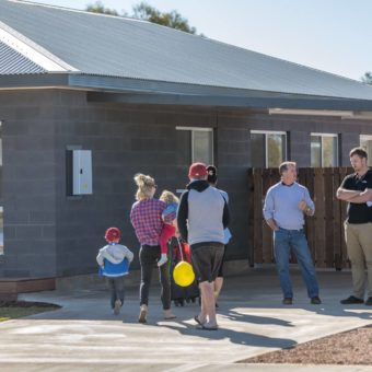 people entering a display home at open day